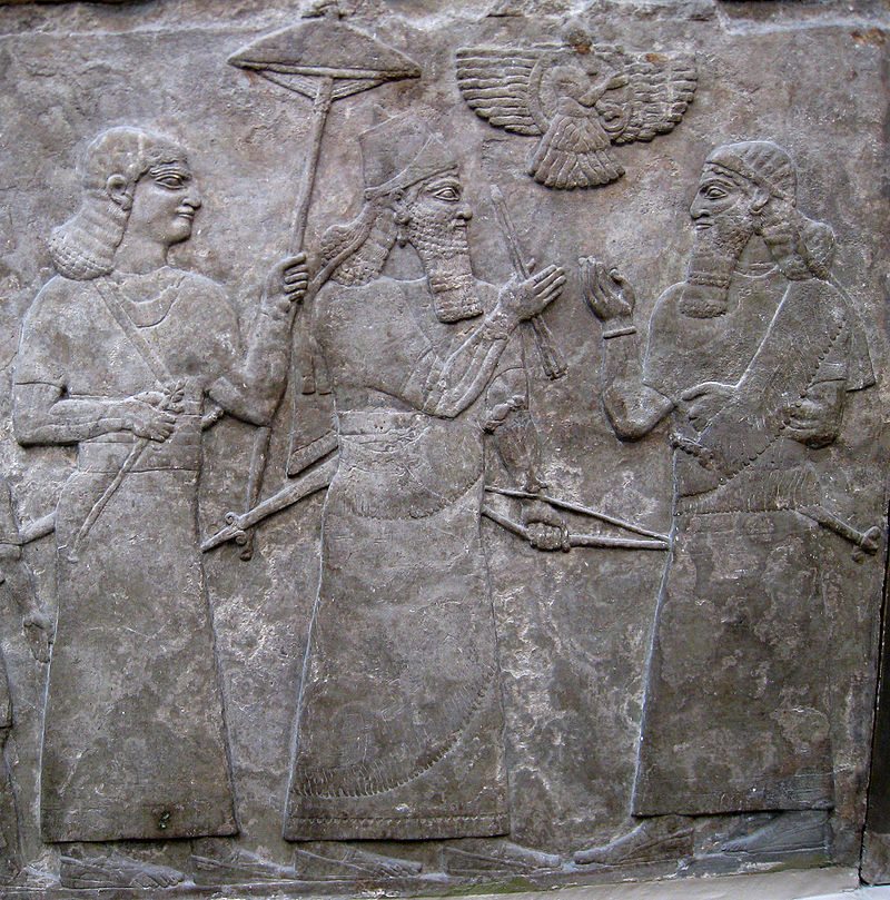 Ashurnasipal_with_official - Ashur-nasir-pal II (centre) meets a high official after a successful battle.