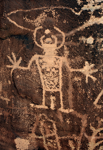 Petroglyph carved into Navajo Sandstone by Native Americans of the Fremont Culture. Fremont peoples were thought to inhabit this area from about 1 to 1200 A.D. McConkie Ranch. Dry Fork Canyon. Uintah Co., Utah.