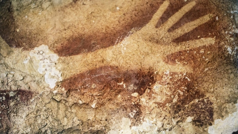 A stencil of an early human's hand in an Indonesian cave is estimated to be about 39,000 years old.