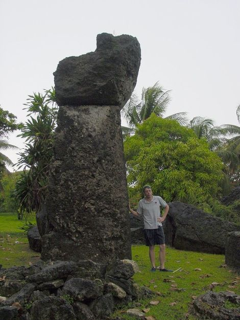 800px-Tinian_latte_stone_at_Taga_House_with_man